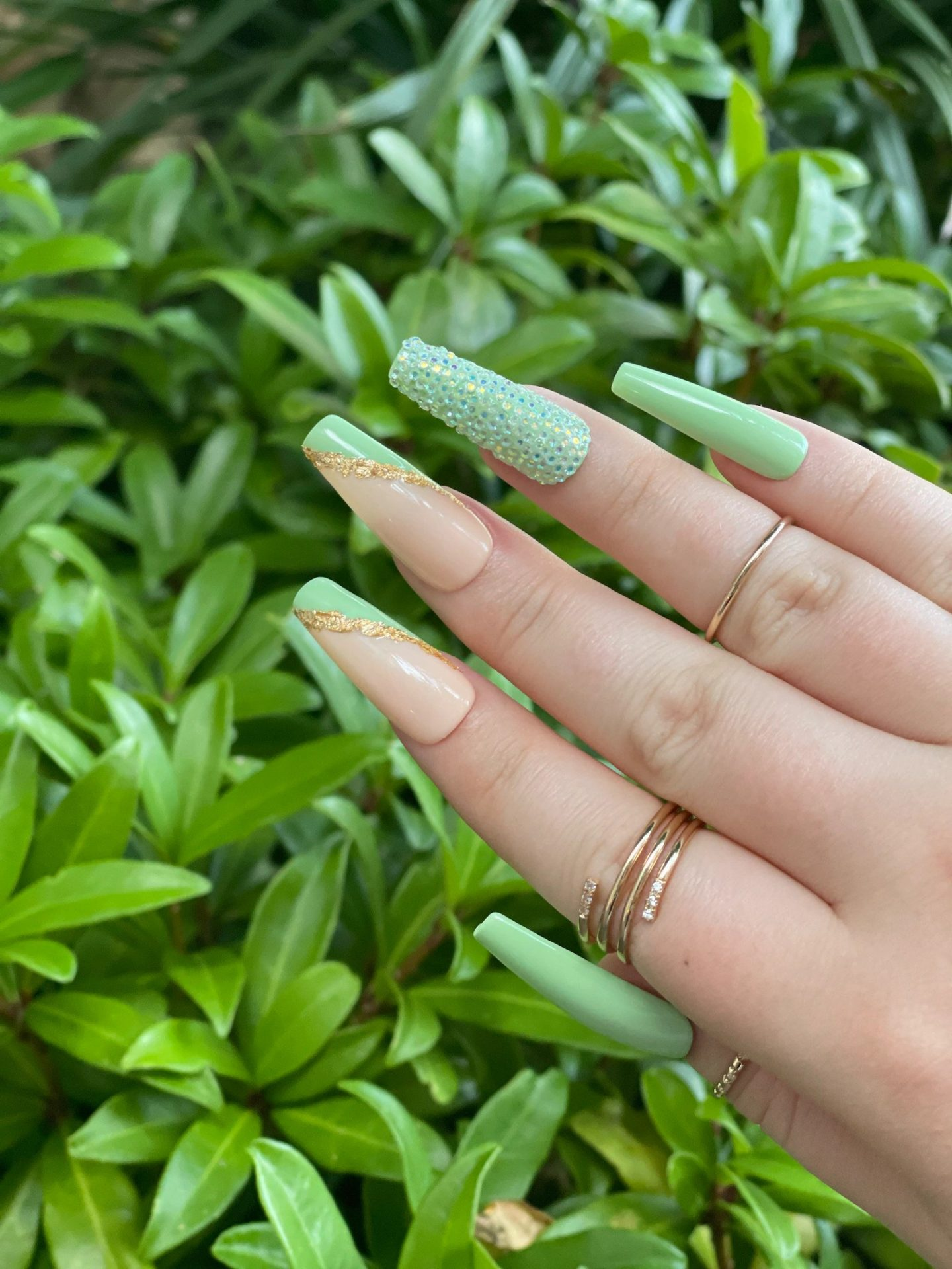 Sage green coffin nails with rhinestones