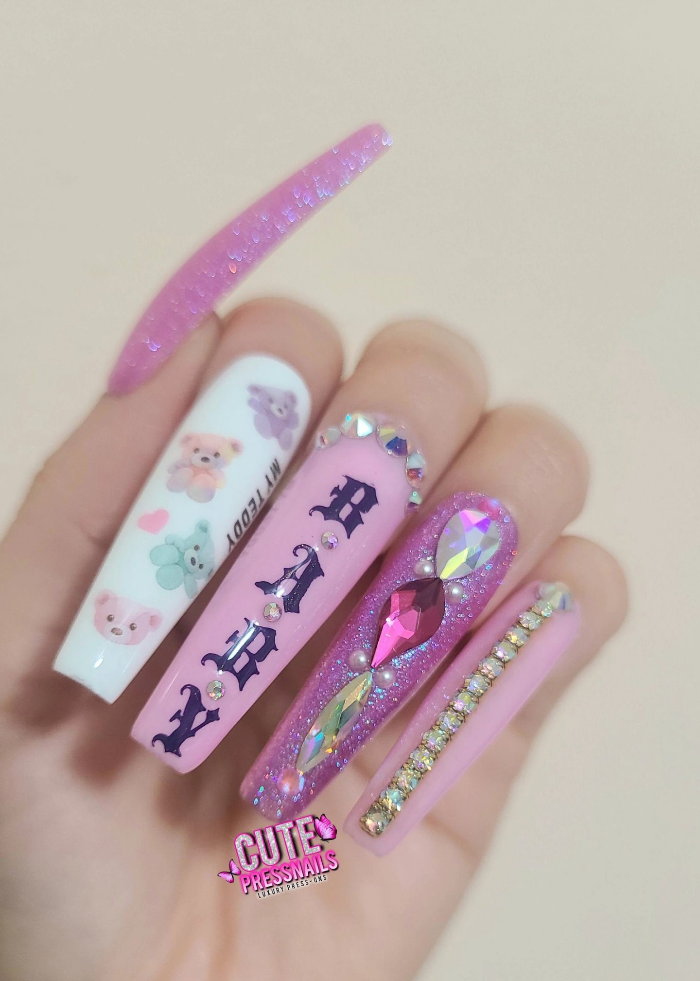 Long pink nails with rhinestone bling and teddy bears