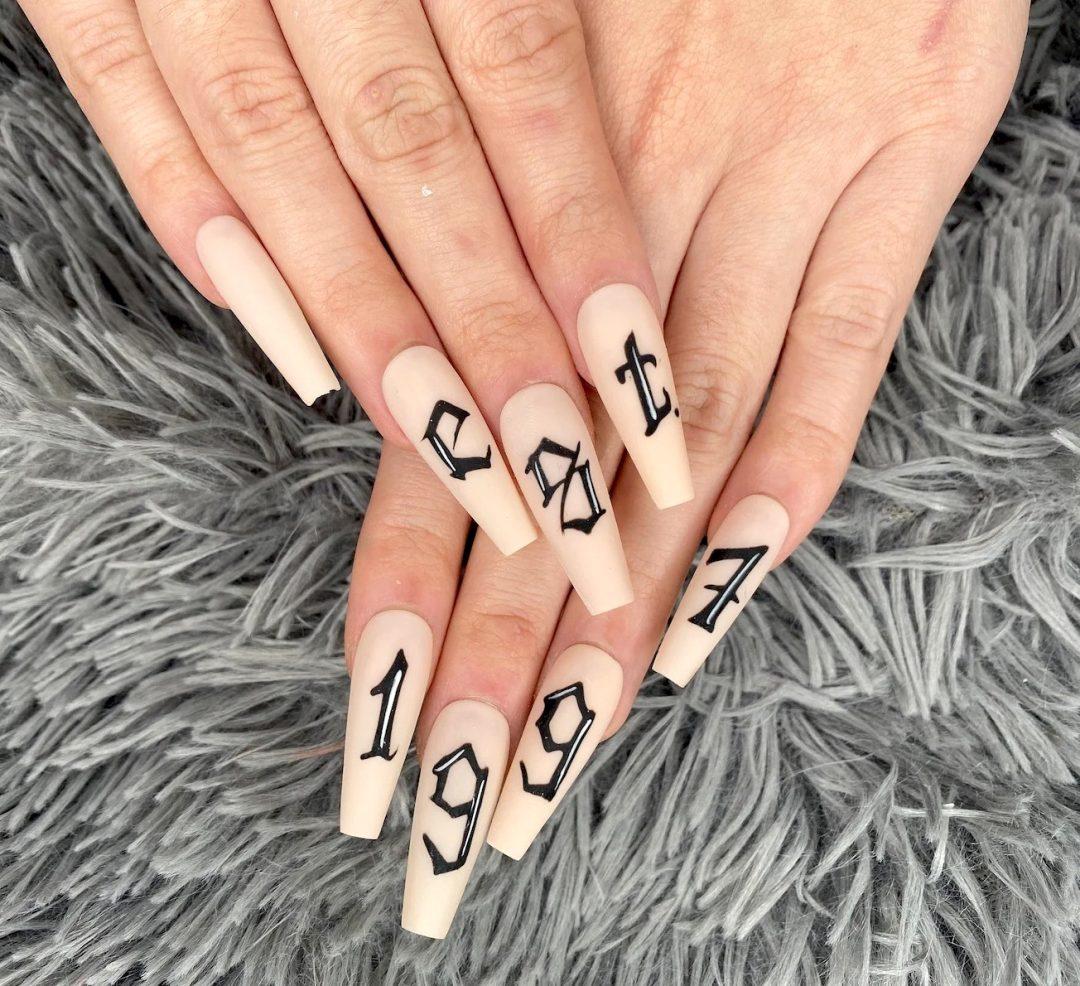 Cute birthday nails with birth year