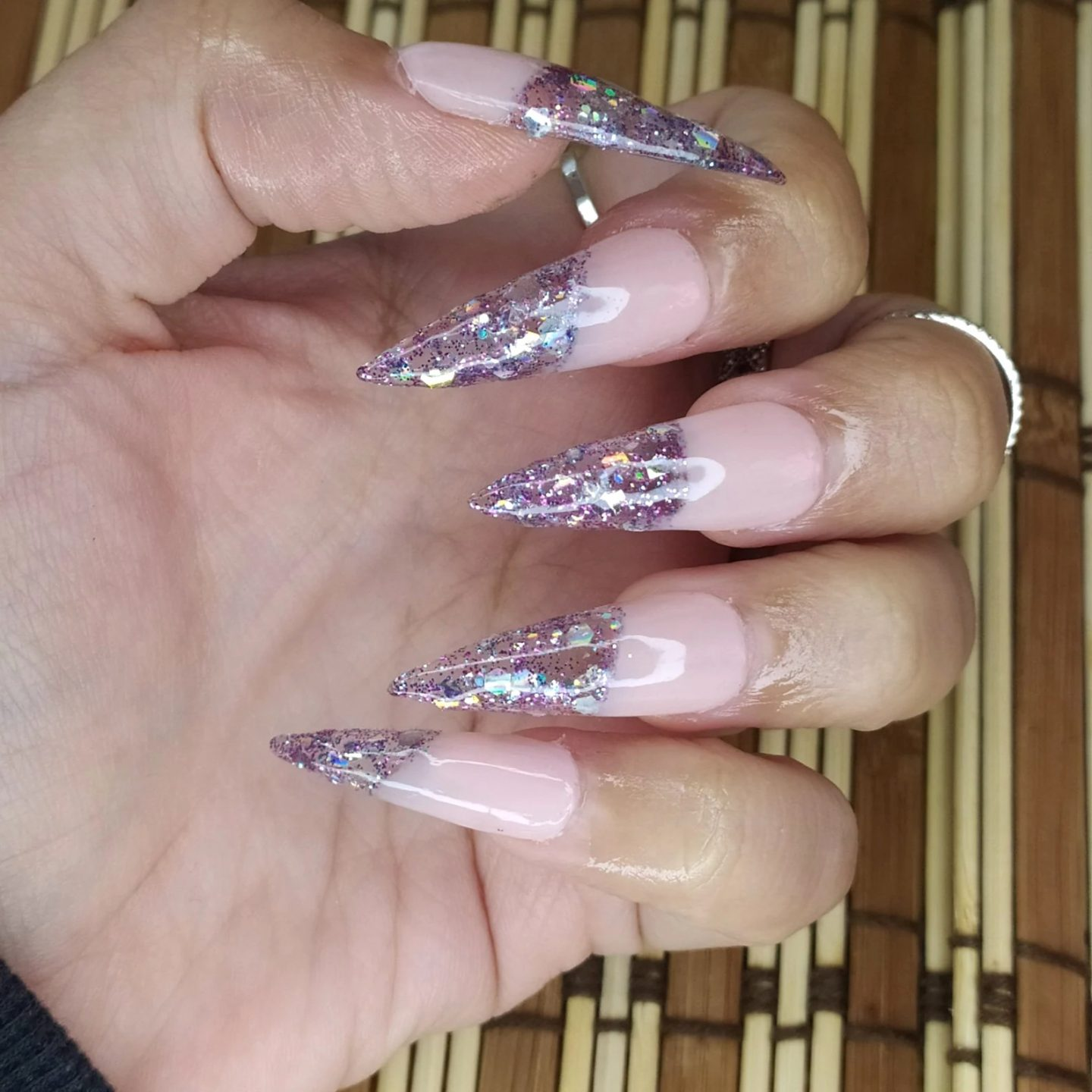 Lavender purple stiletto nails with glitter French tips