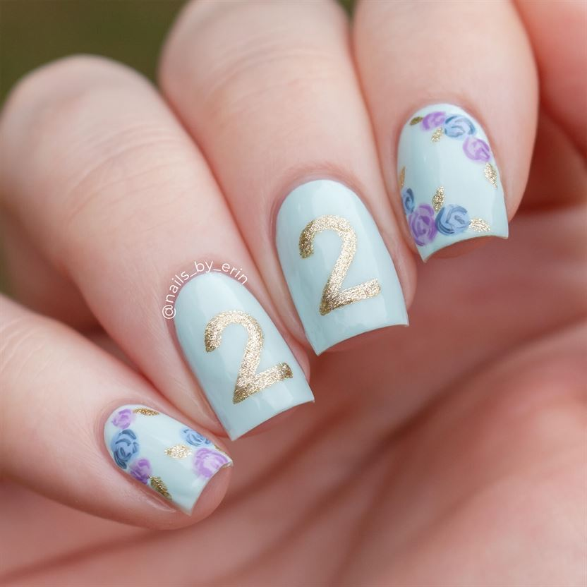 Cute light blue birthday nails with 22