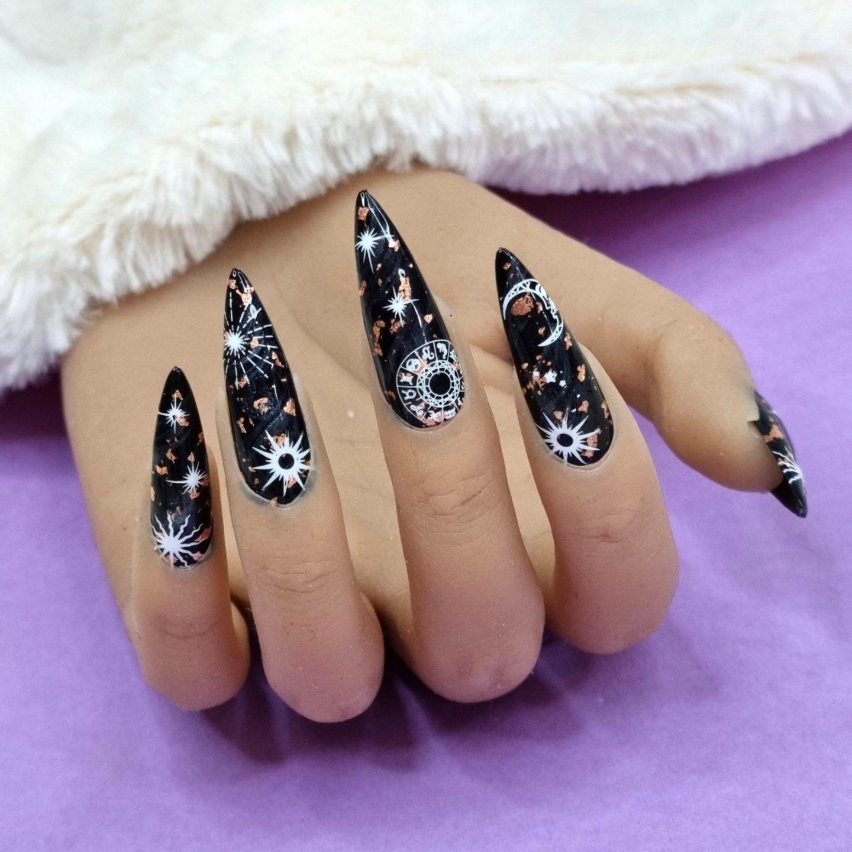 Long black celestial zodiac nails in stiletto shape