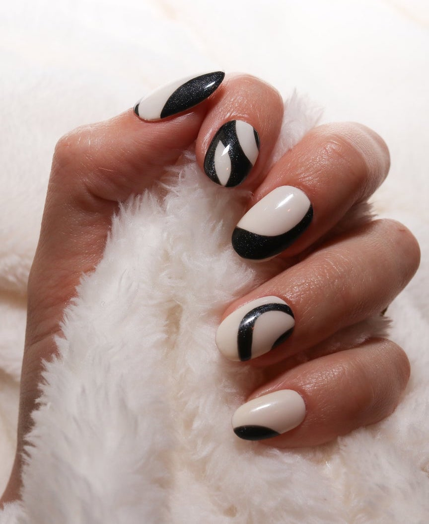 Short abstract black and white swirl nails