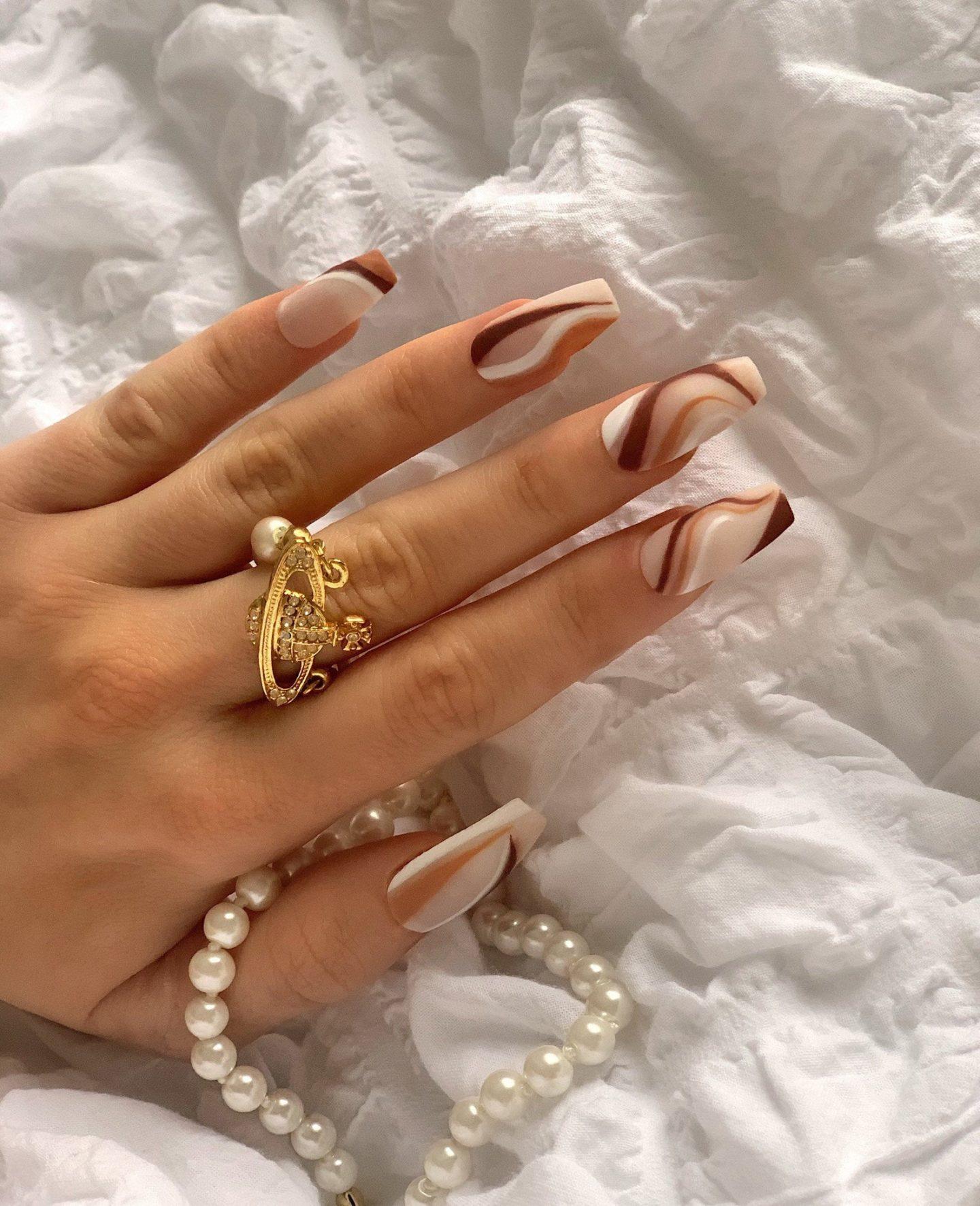 Matte brown swirl nails