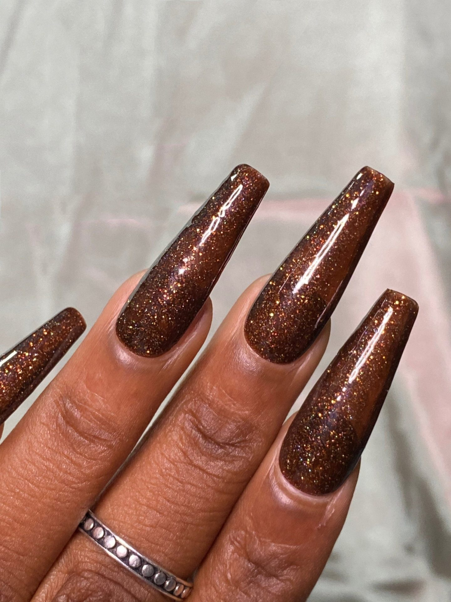 Brown coffin nails with glitter