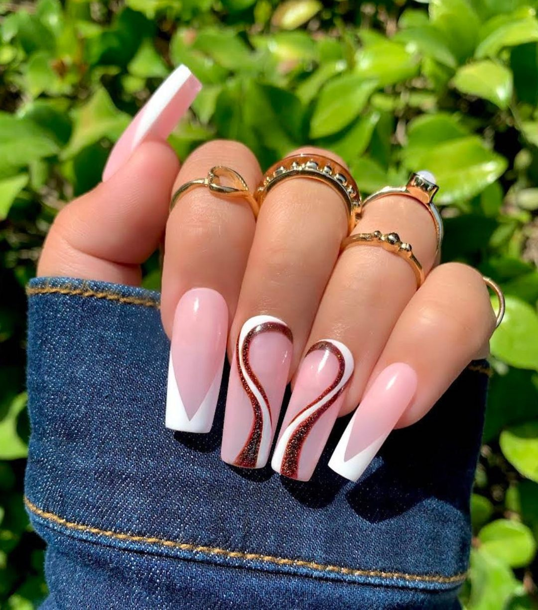 White French tip nails with brown hearts