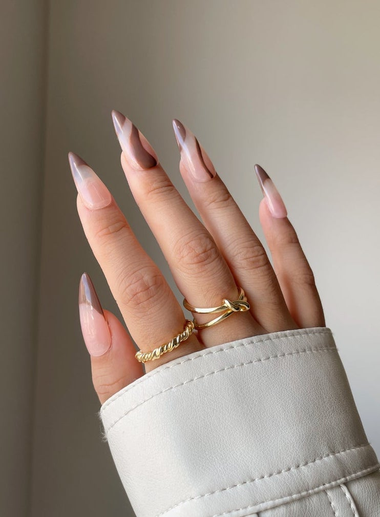 Brown abstract nails with French tips and lines
