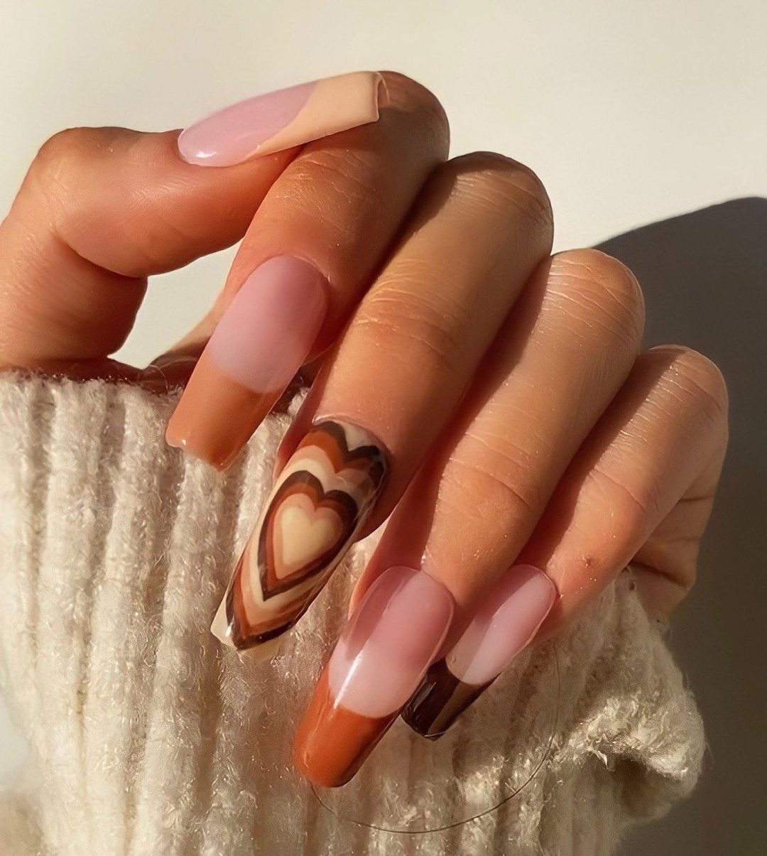 Brown French tip nails with hearts and ombre effect