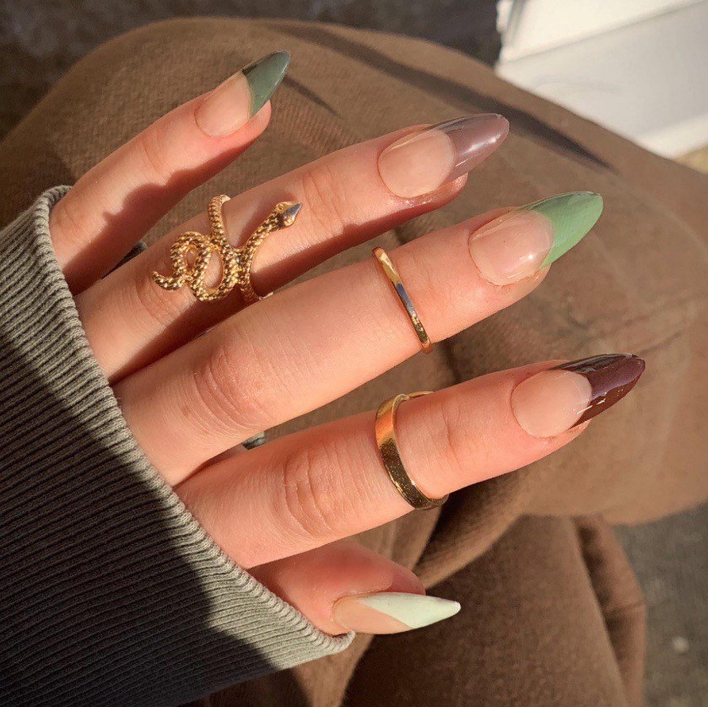 Green and brown French tip nails in almond shape