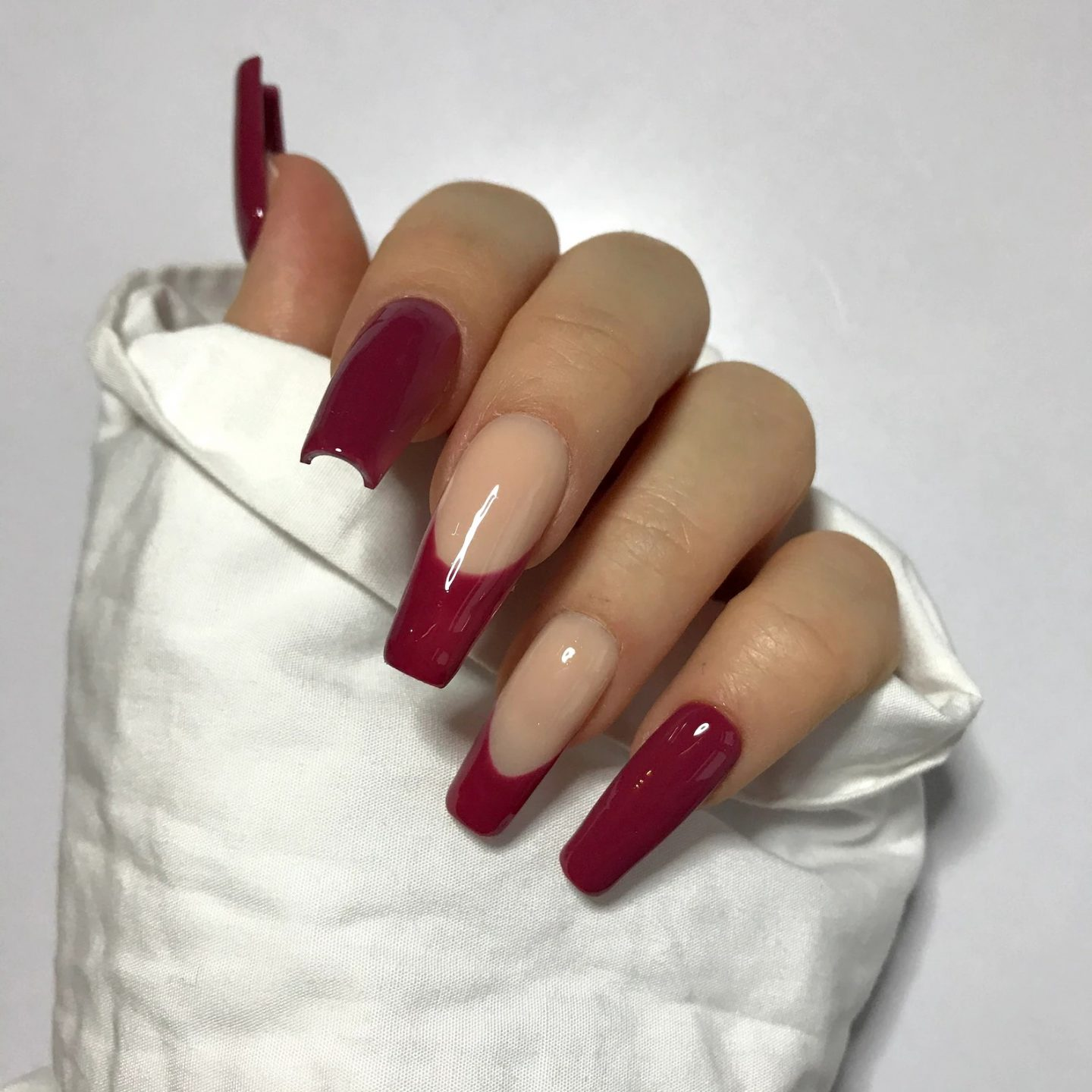 Cute burgundy nails with French tips