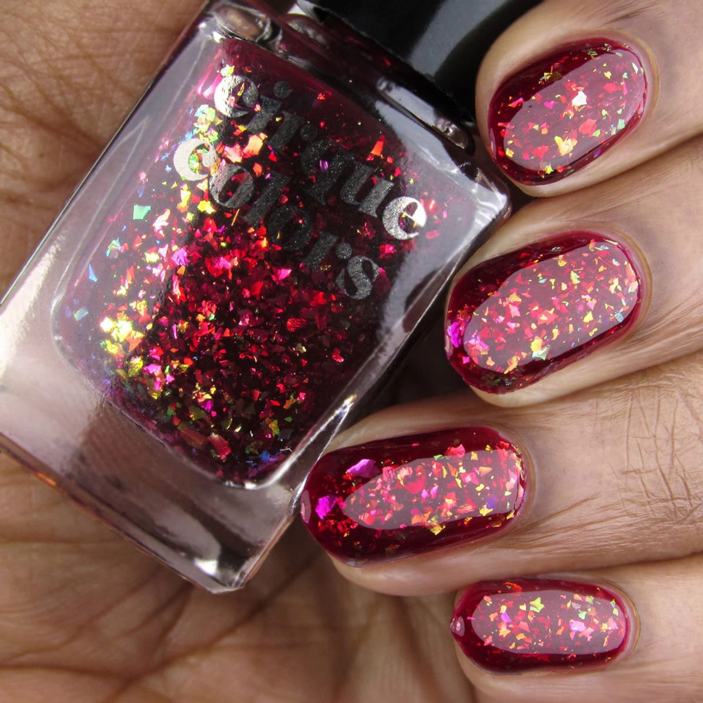 Holographic burgundy nail polish with glitter