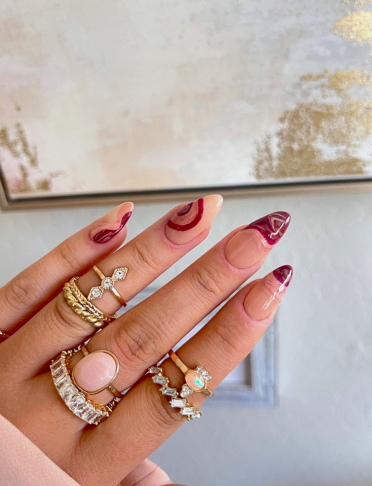 Burgundy abstract nails with swirls