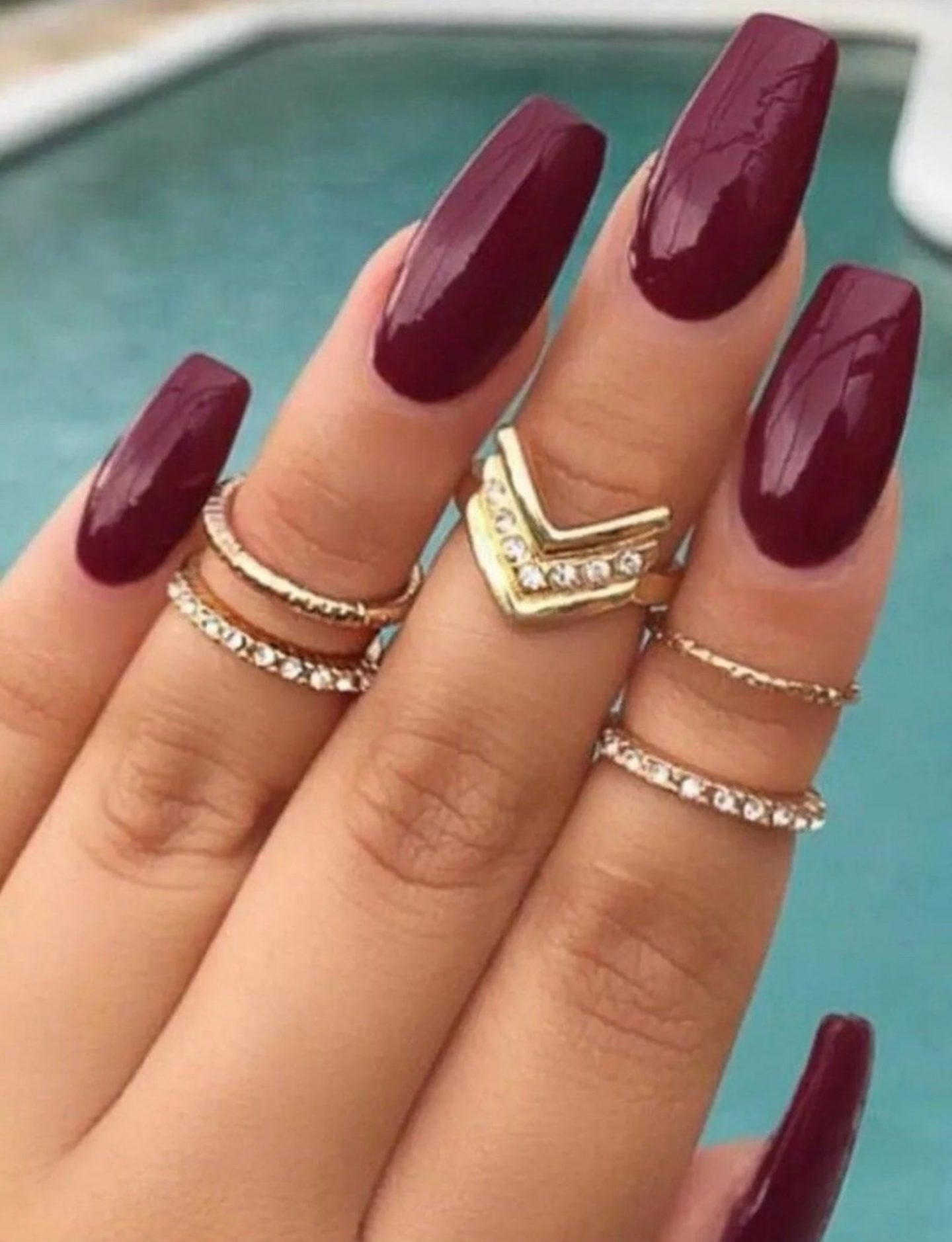 Wine red sangria nails with midi rings