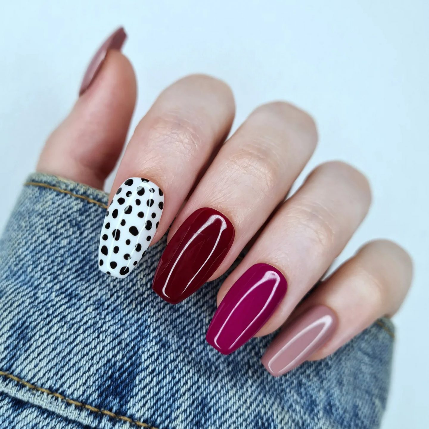 Ombre burgundy and maroon nails with black and white polka dots