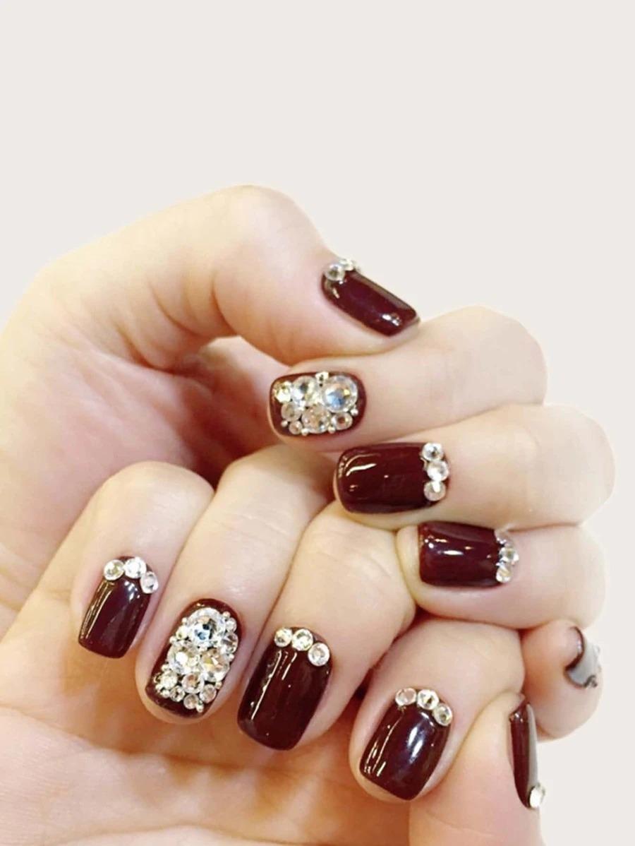 Cute short burgundy nails with rhinestones