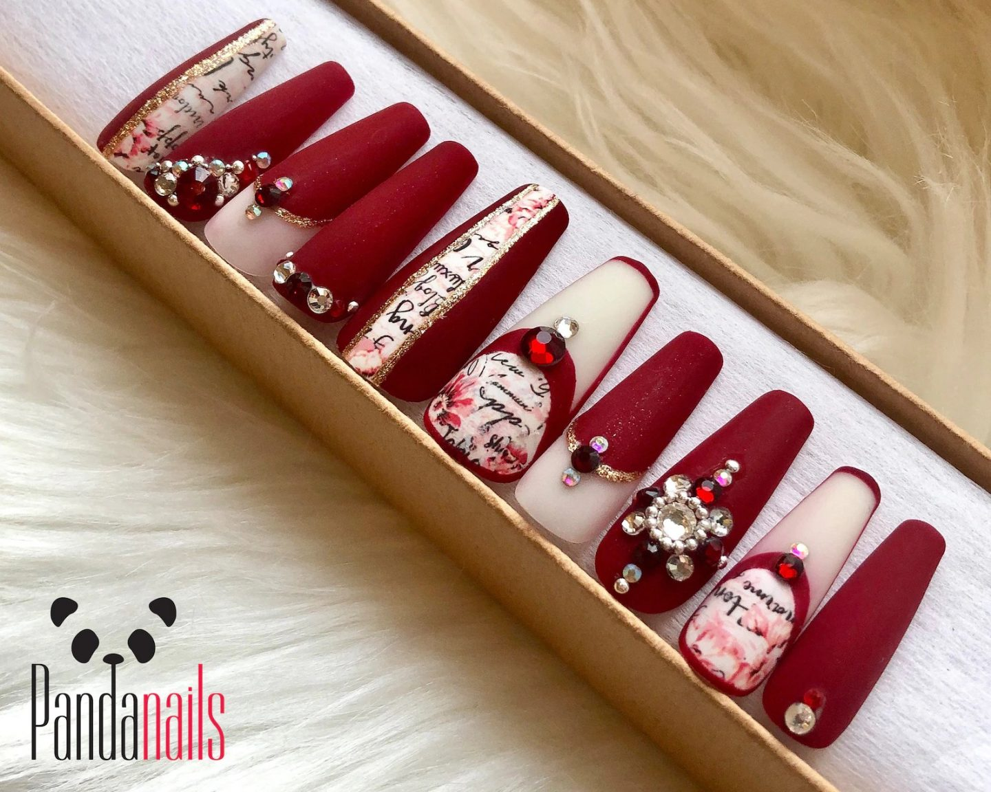 Matte white and burgundy Christmas nail designs with rhinestones