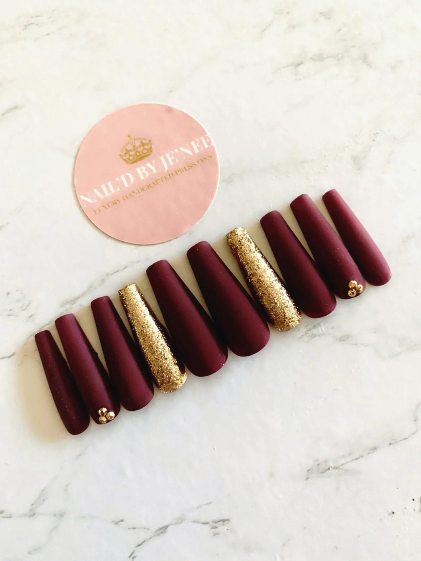 Velvet burgundy nails with gold foil and glitter