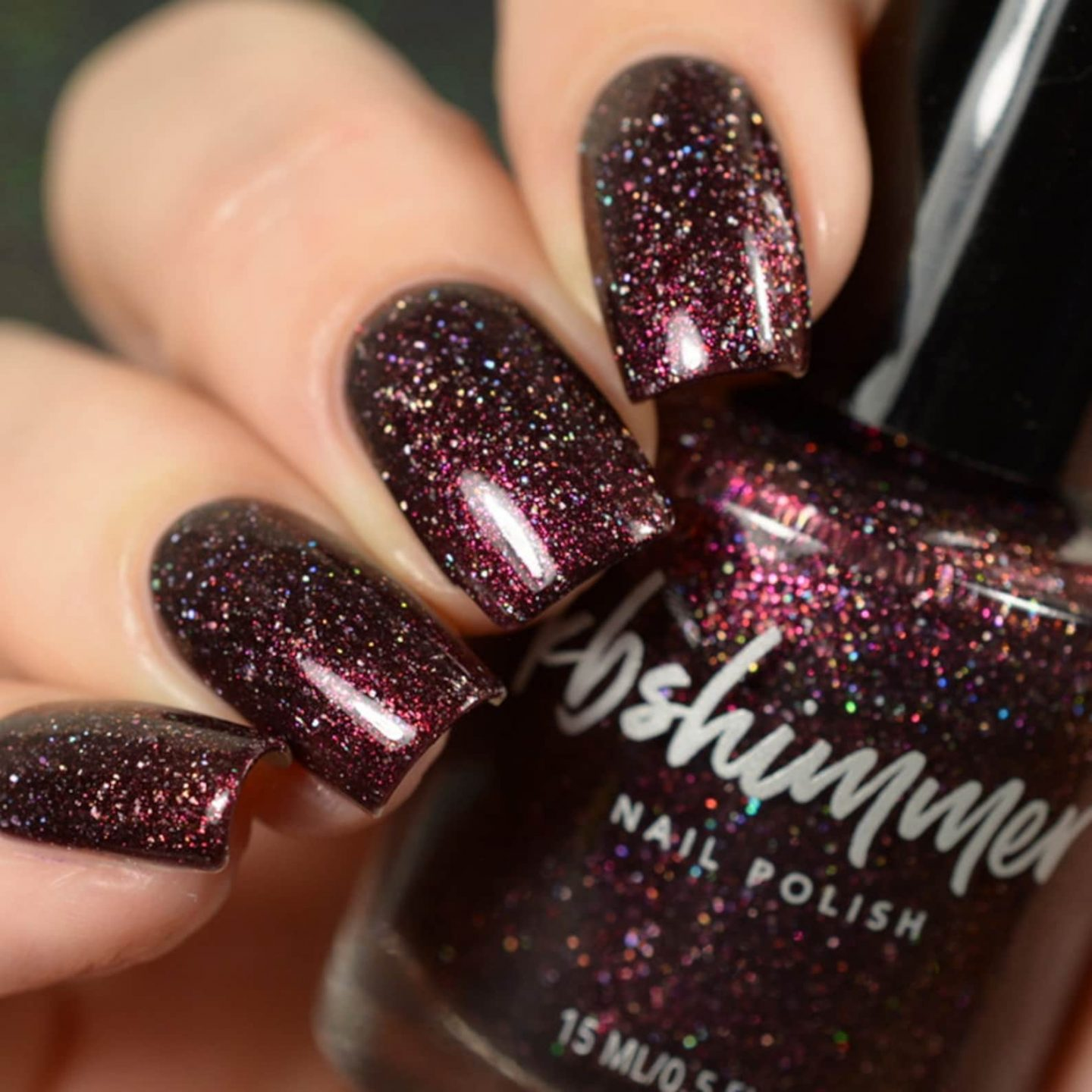 Holographic and iridescent maroon nail polish with glitter