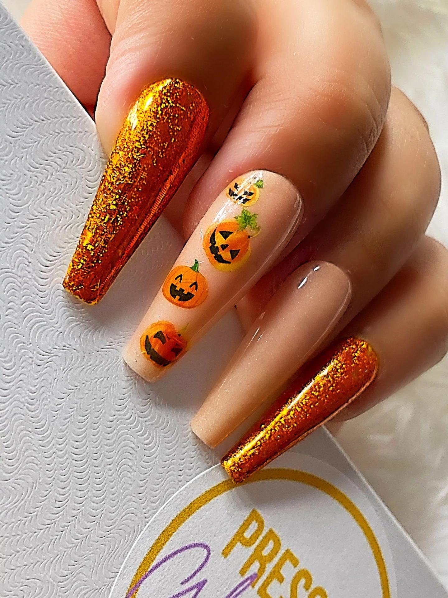 Burnt orange glitter nails with Halloween pumpkins