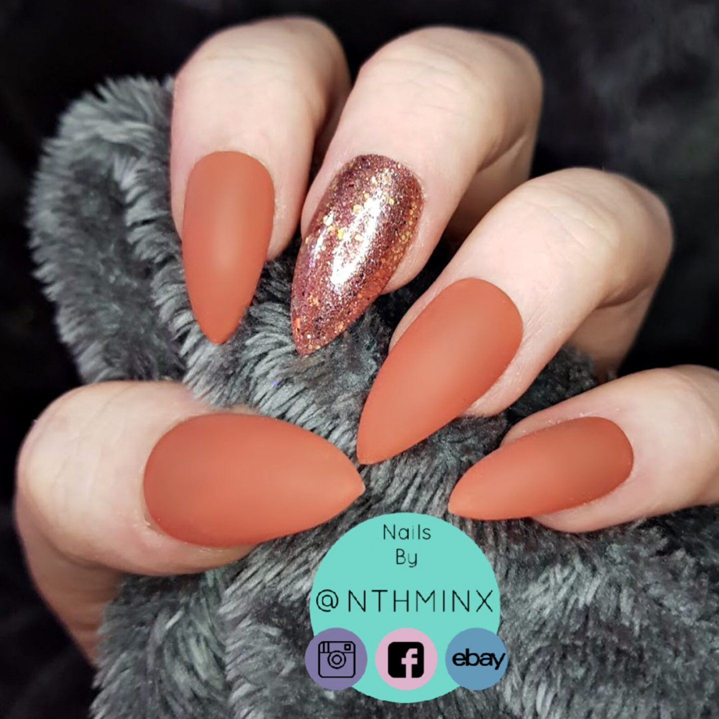 Matte brown almond nails with glitter