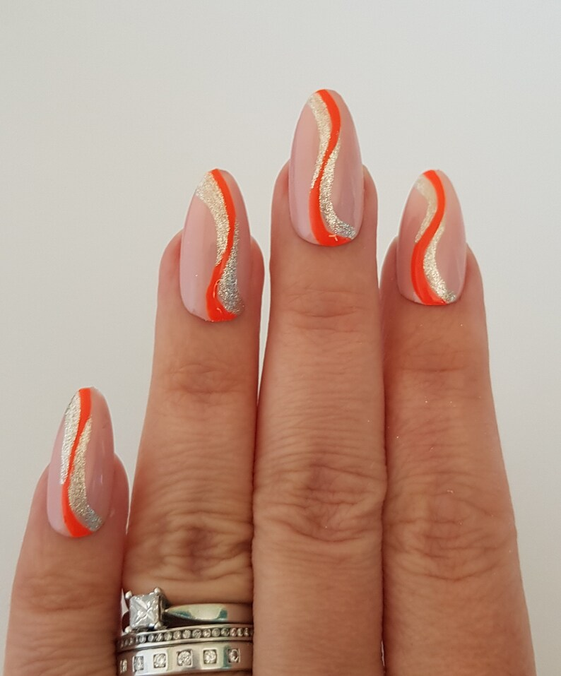 Burnt orange abstract swirl nails with glitter