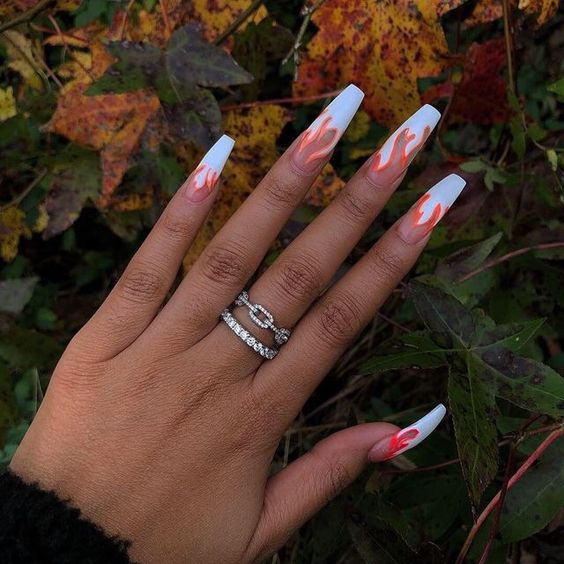 Transparent white and orange flame nails