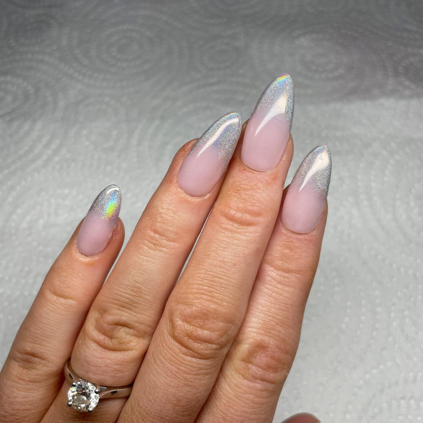 Cute holographic silver chrome French tip nails in almond shaoe