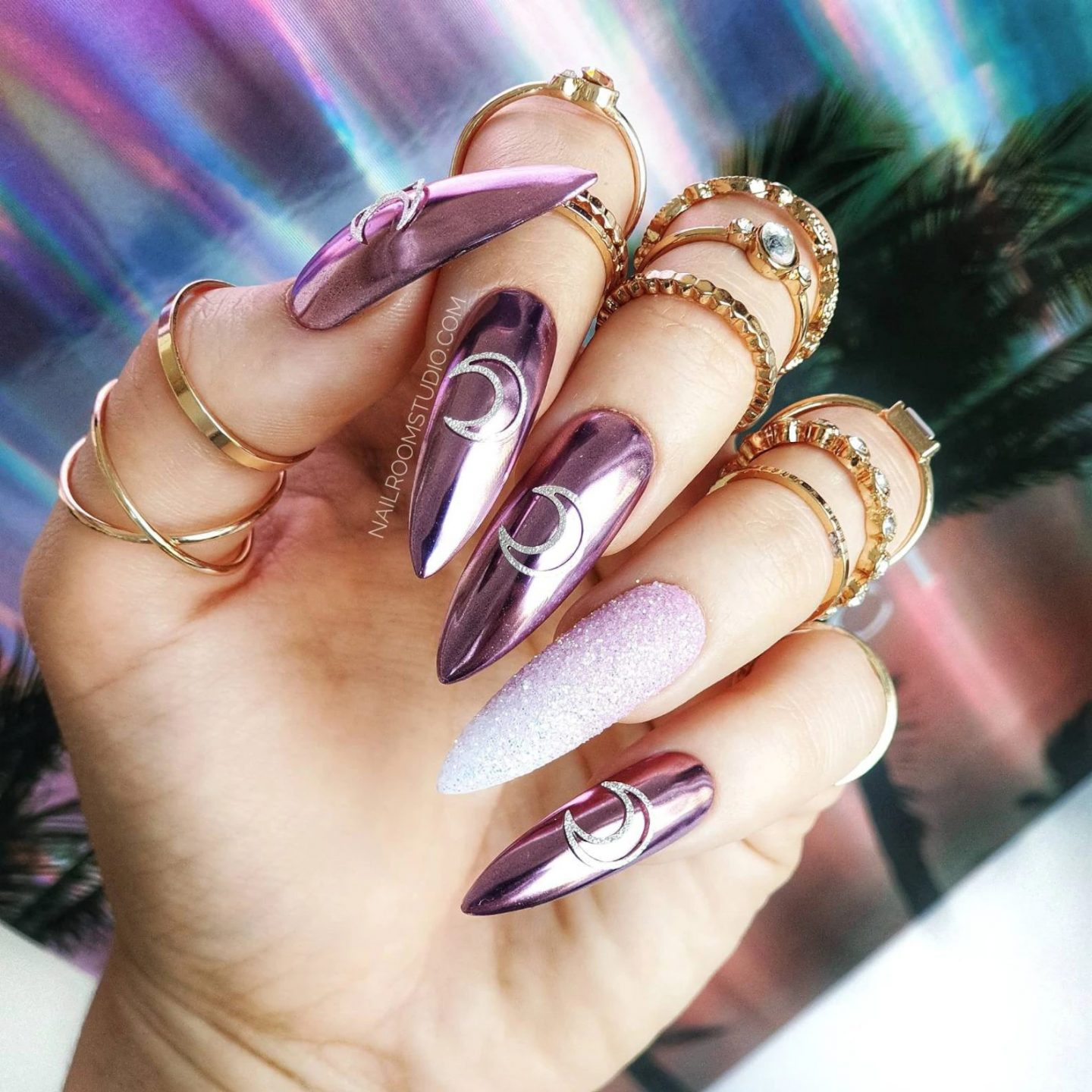 Pink metallic stiletto nails with glitters