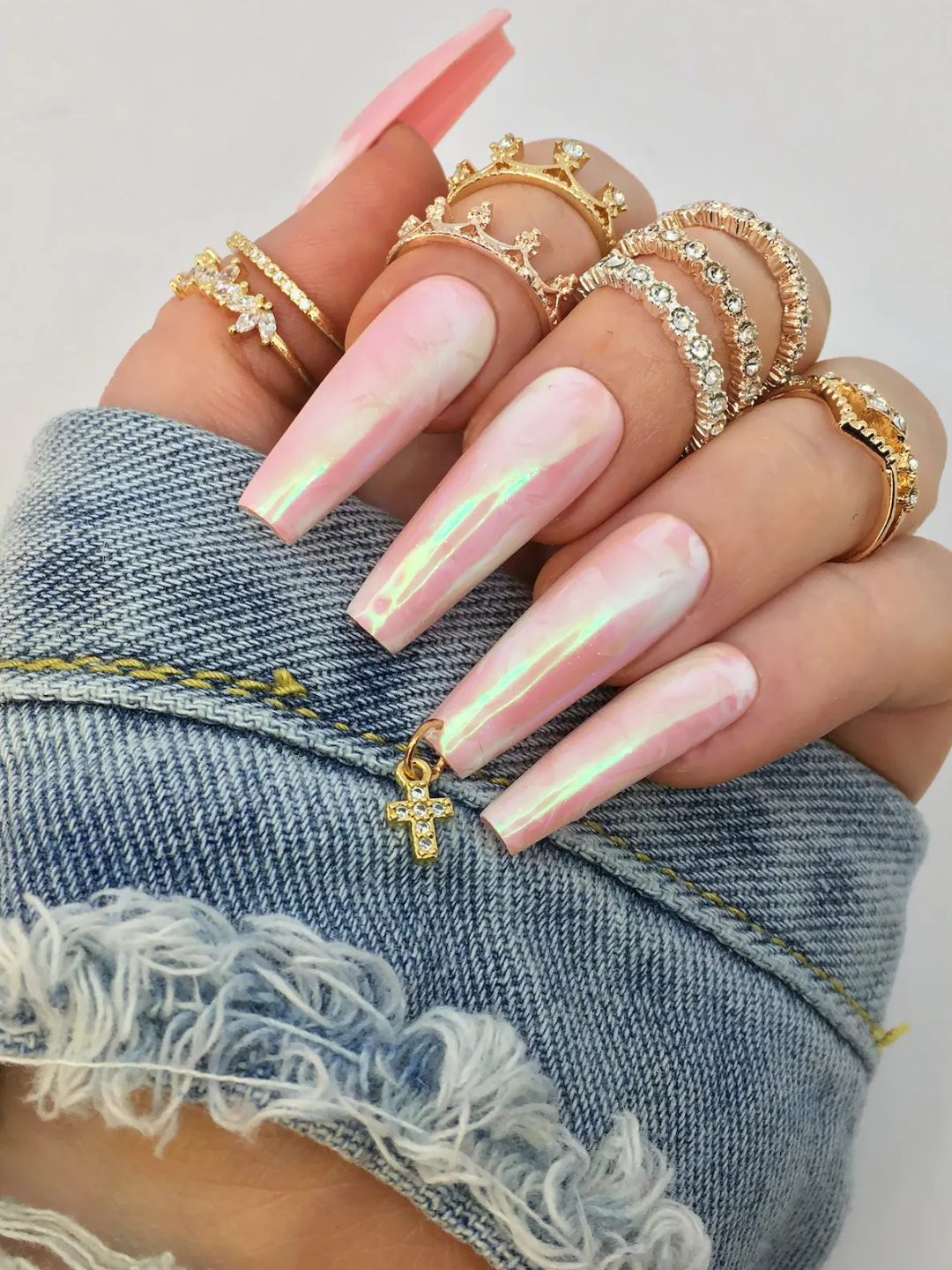 Long holographic pink chrome nails with marble nail art