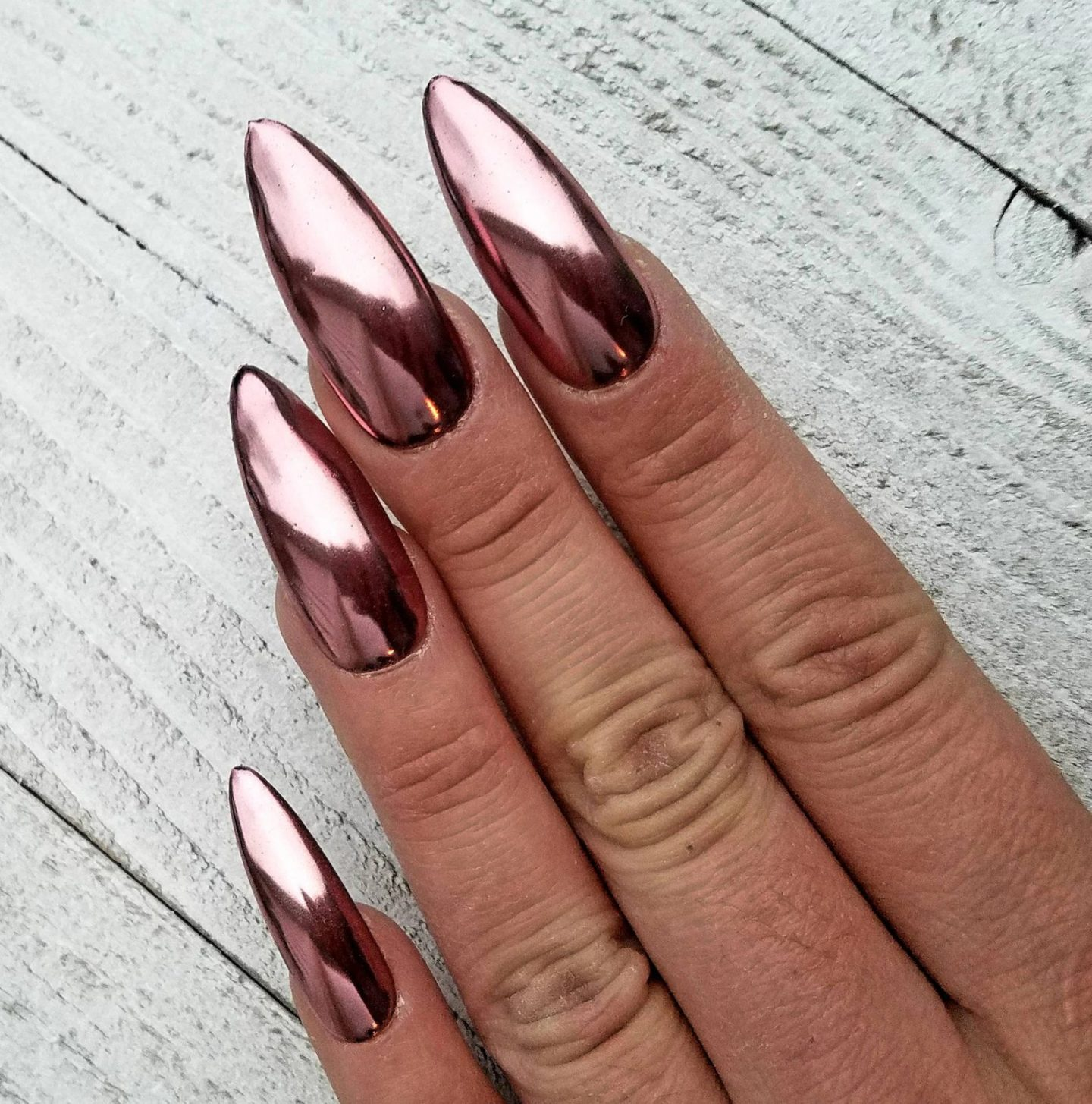 Long metallic rose gold nails with chrome effect