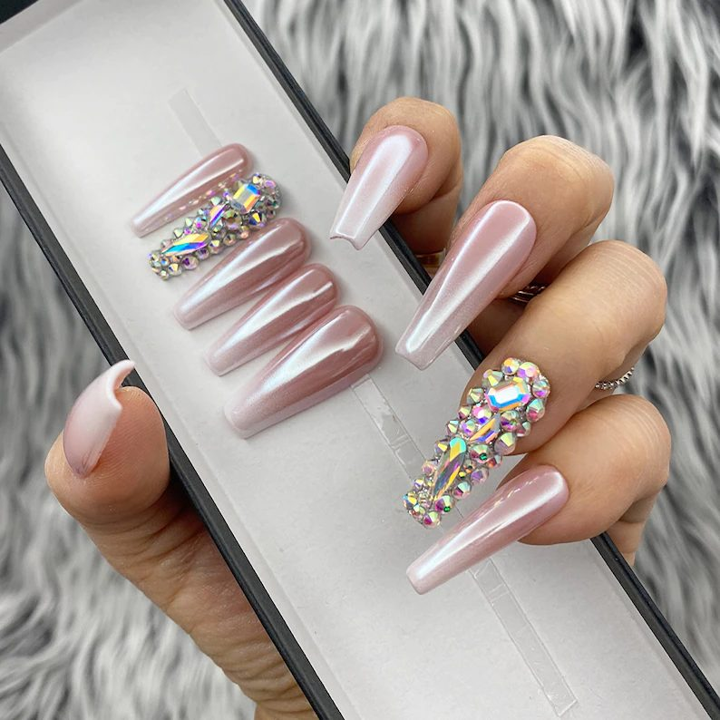 Light pink ombre nails with chrome effect and rhinestones