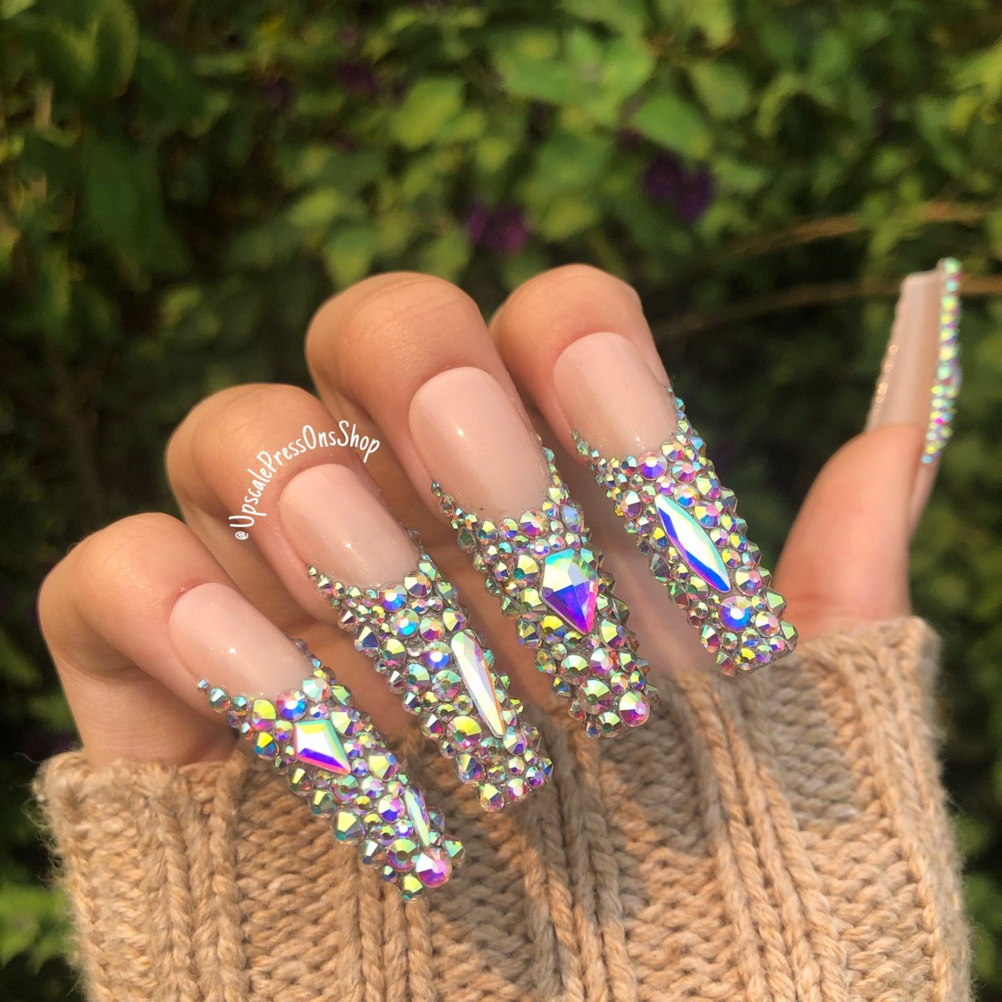 Long nude coffin nails with rhinestones and crystals