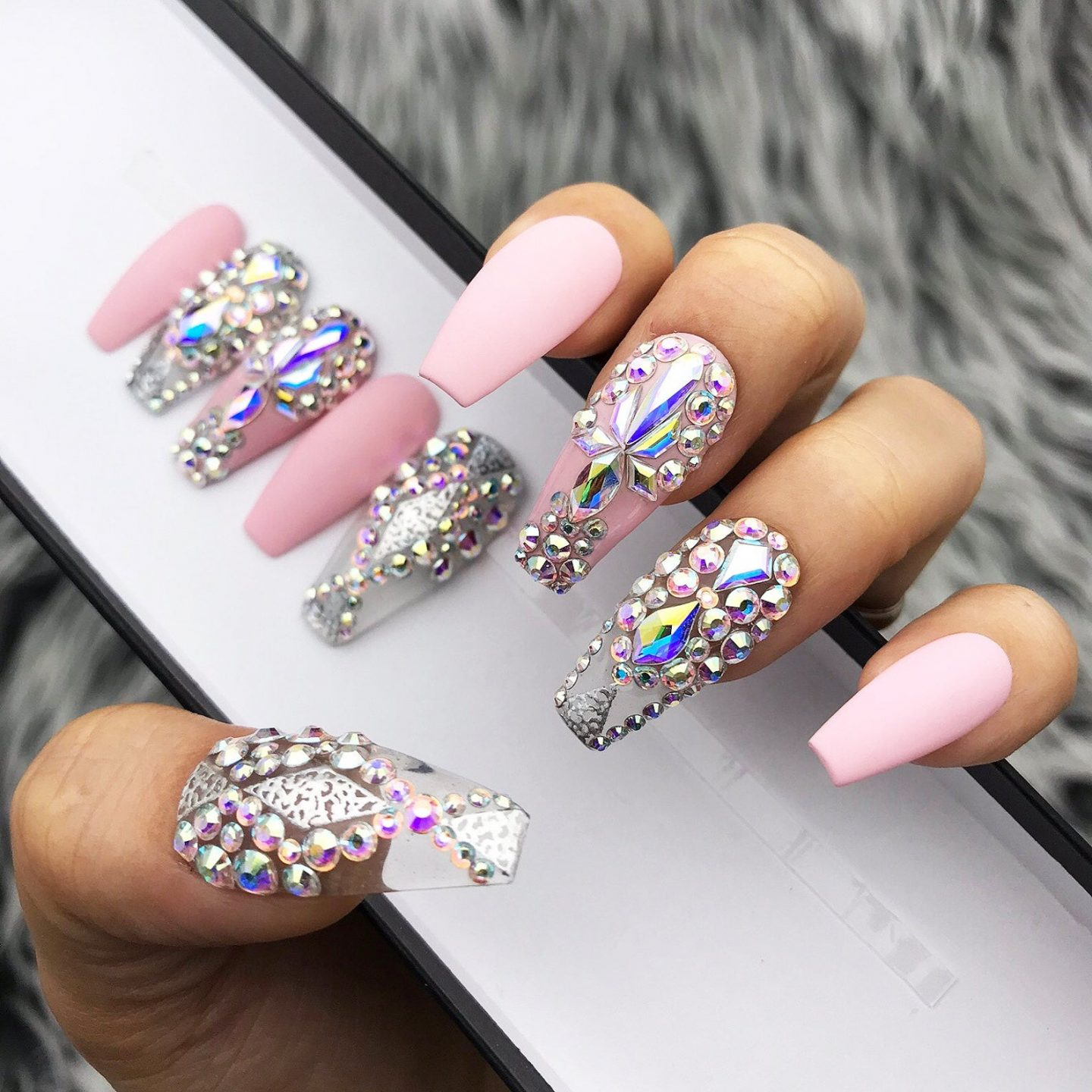 Matte light pink coffin nails with rhinestones
