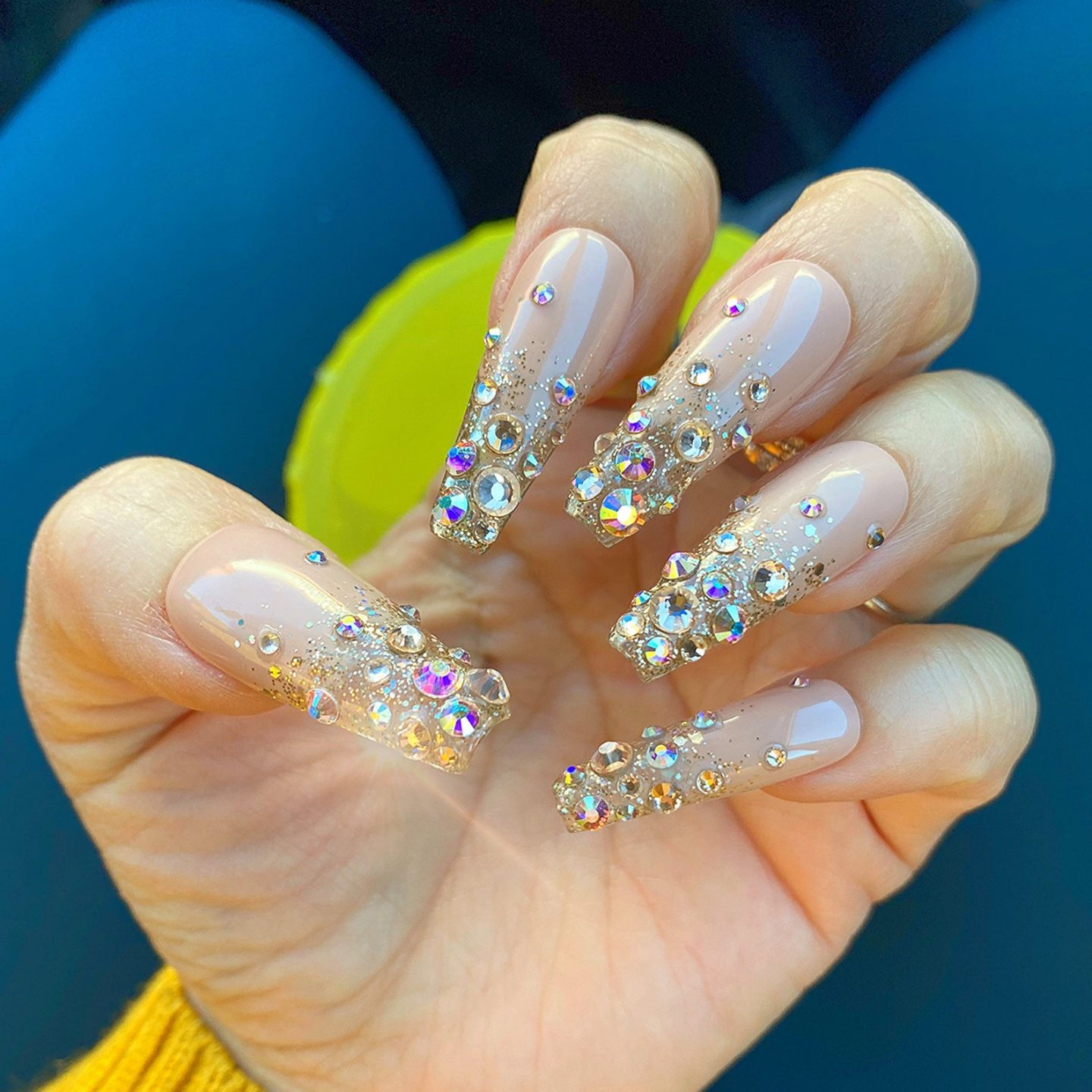 Long nude coffin nails with rhinestones and diamonds