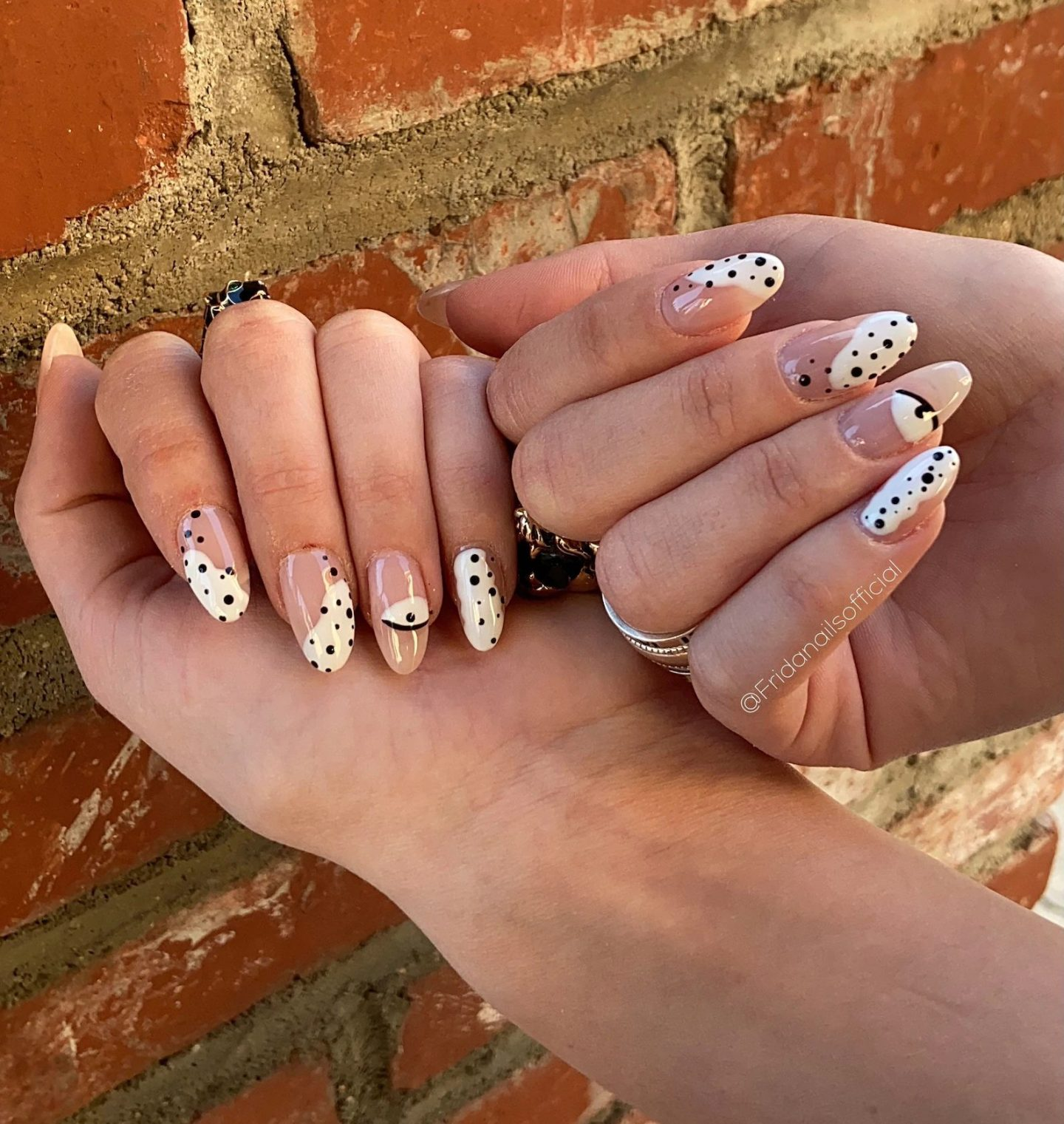 Cute abstract white nails with black polka dots