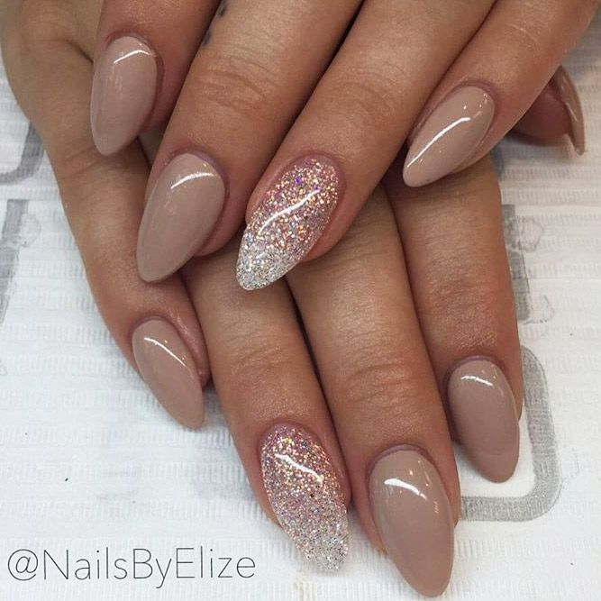 Nude almond nails with glitter