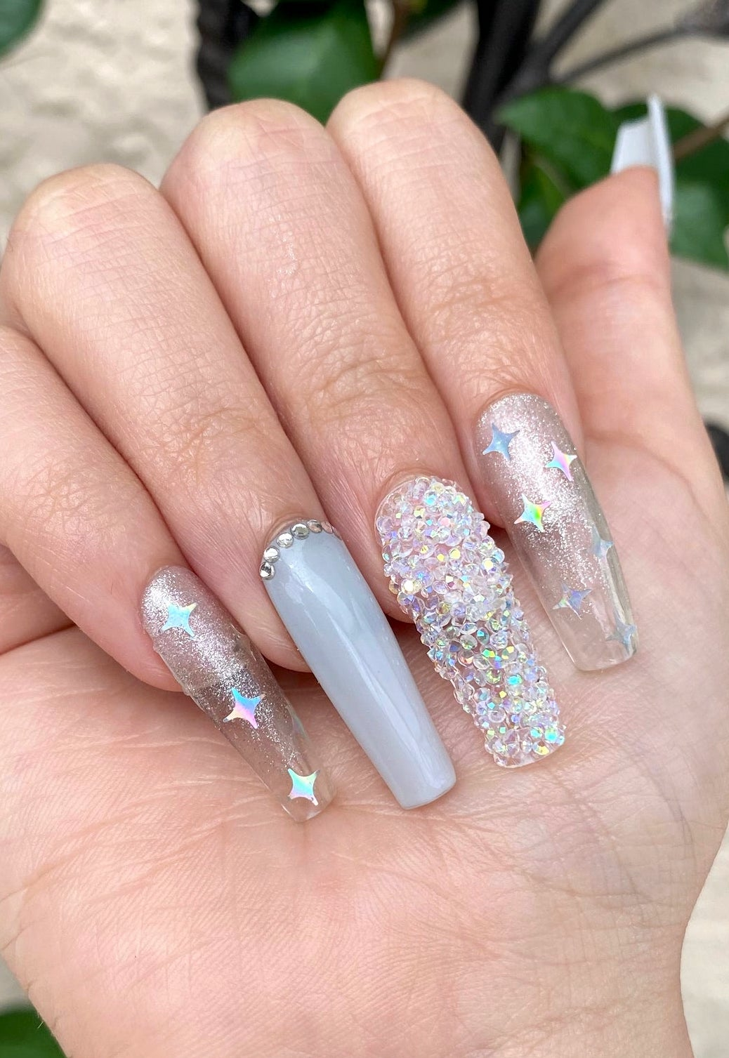 Light grey nails with transparent and glitter accents