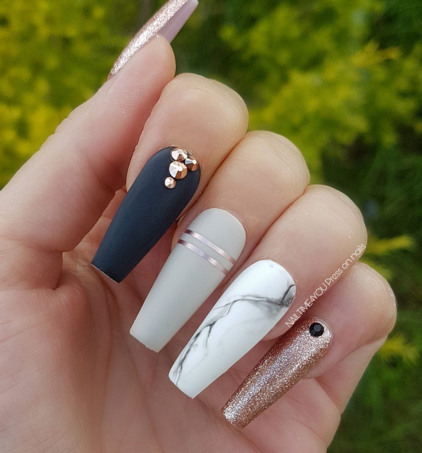 Matte black and grey marble nails with rose gold glitter