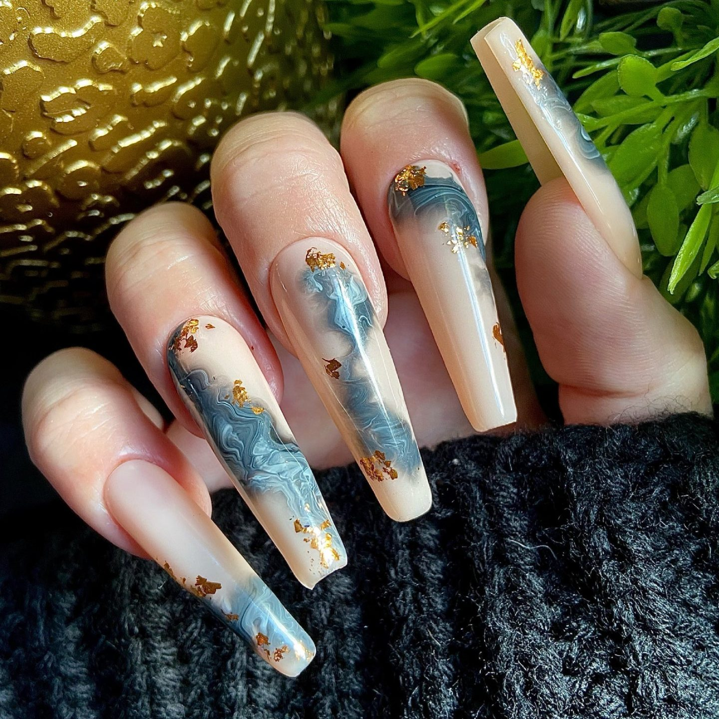 Nude and grey marble nails with gold flakes