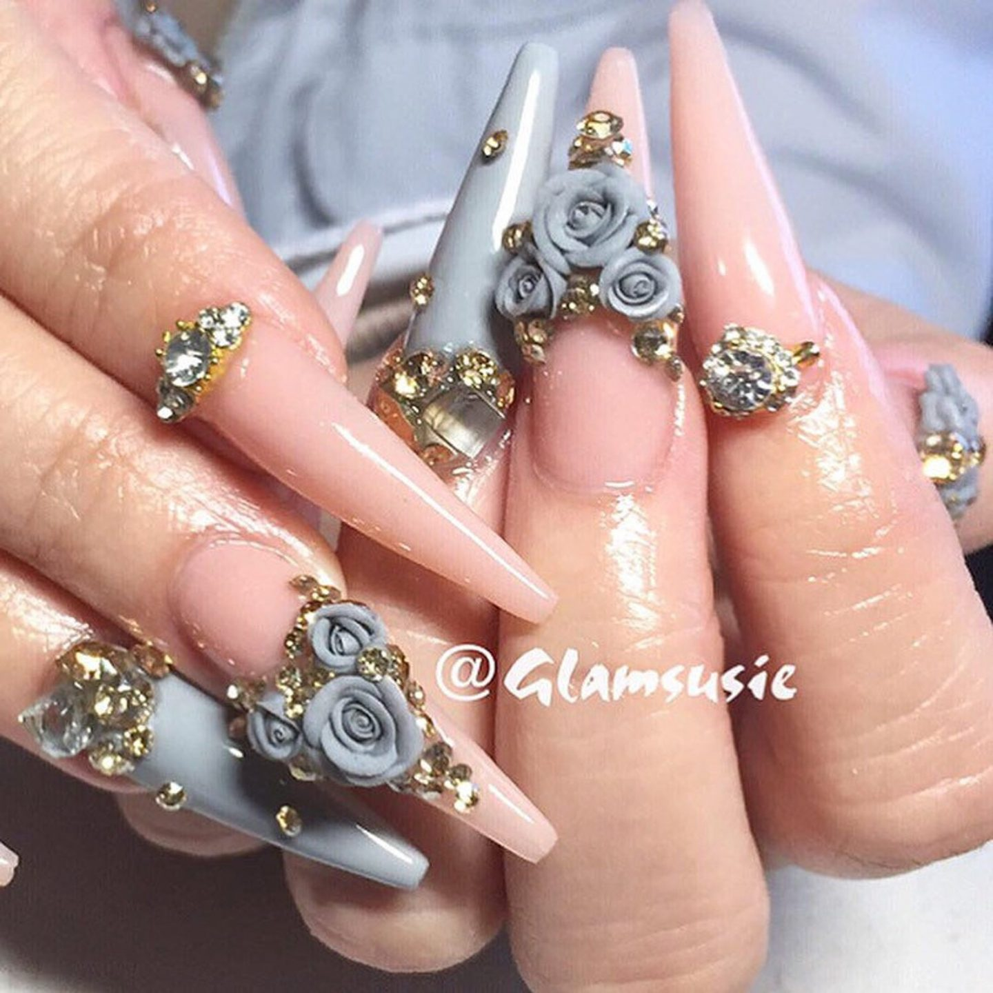 Light grey and pink stiletto nails with roses and rhinestones