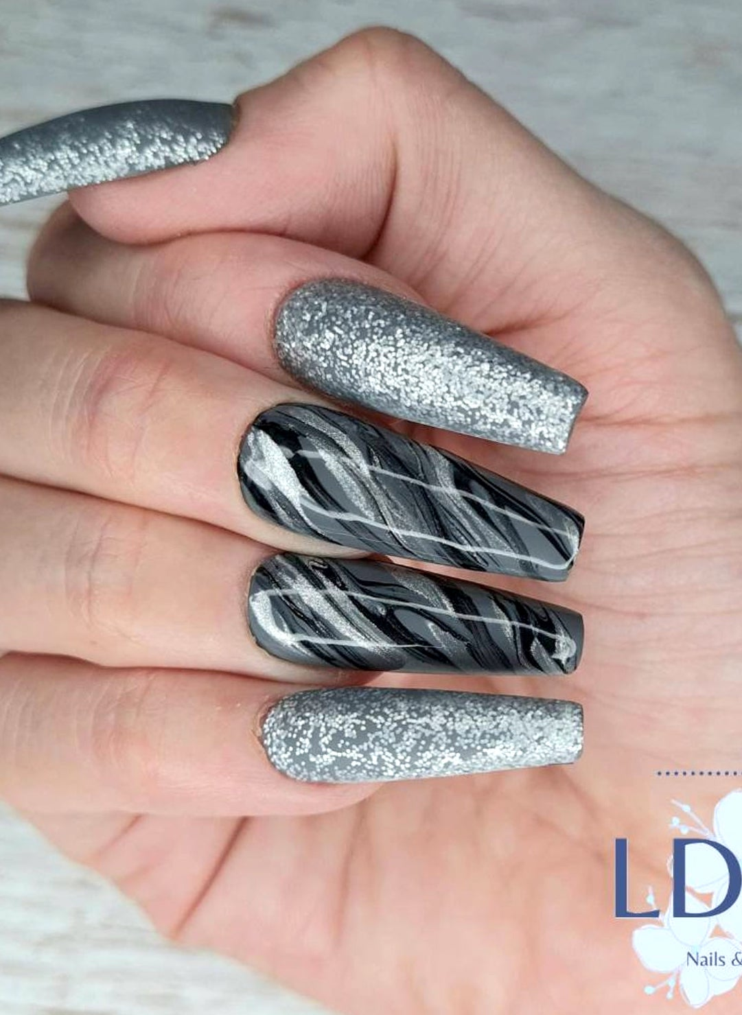 Dark grey marble nails with silver glitter