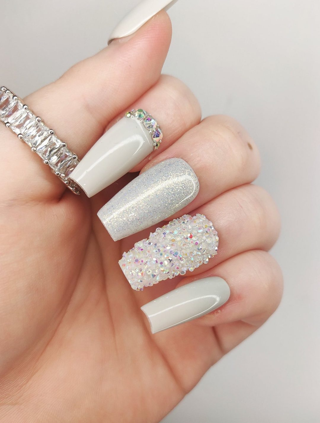 White and light grey coffin nails with glitter