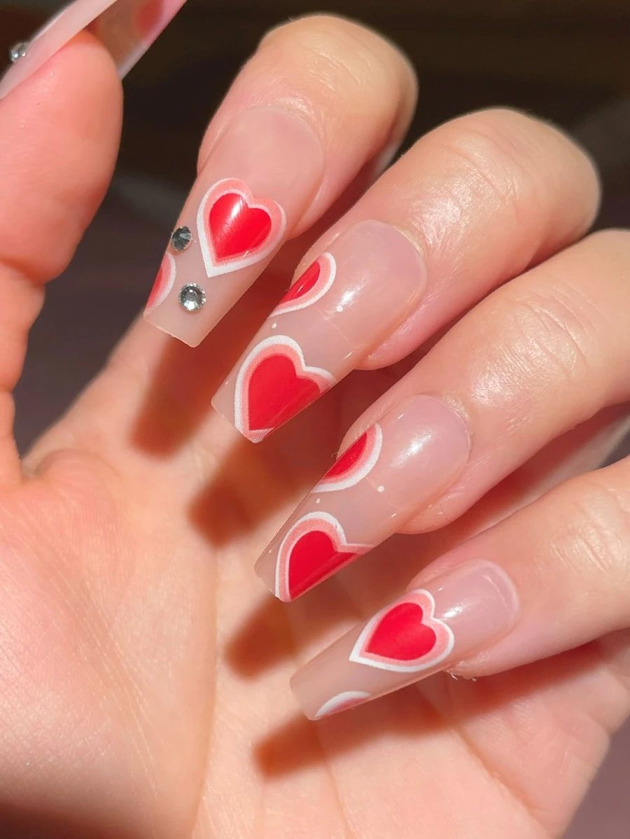 Long nude coffin nails with red hearts