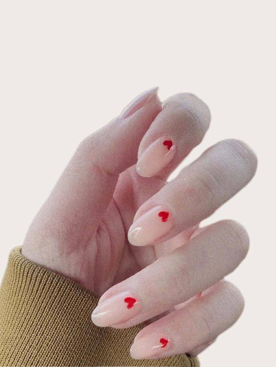 Cute minimalist nude nails with heart nail art