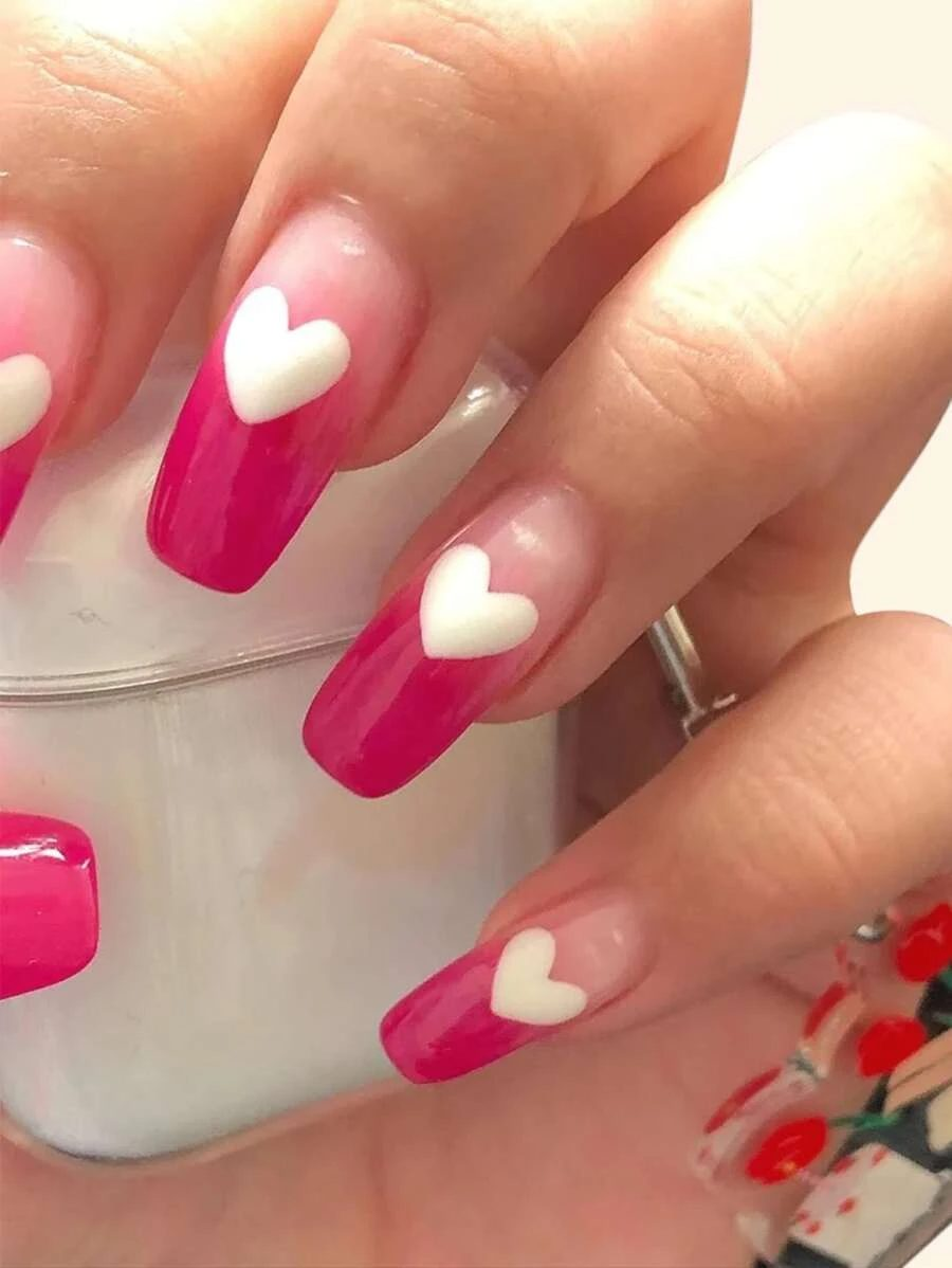 Cute long hot pink French tip nails with white hearts