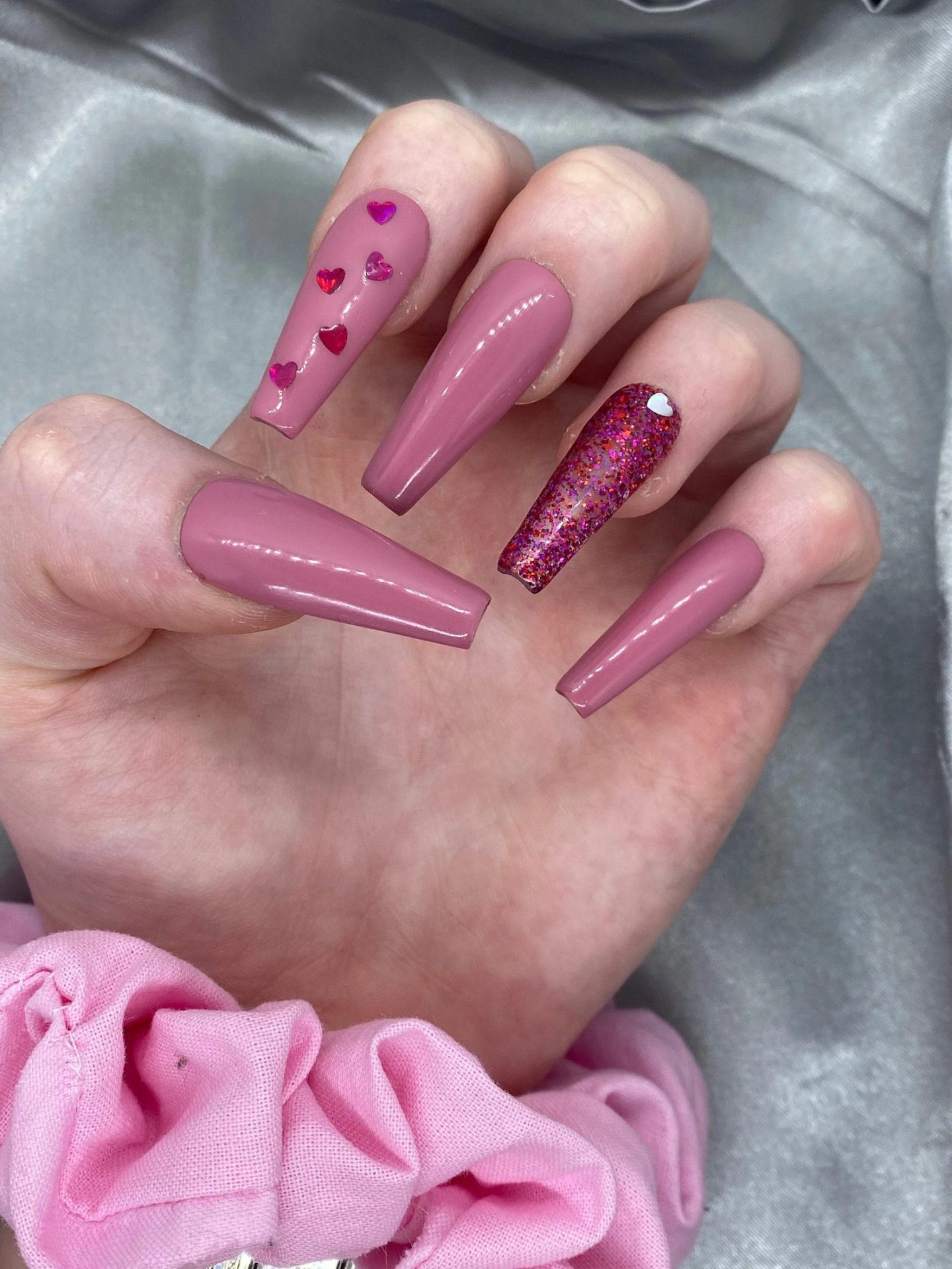 Mauve and pink heart nails with glitter