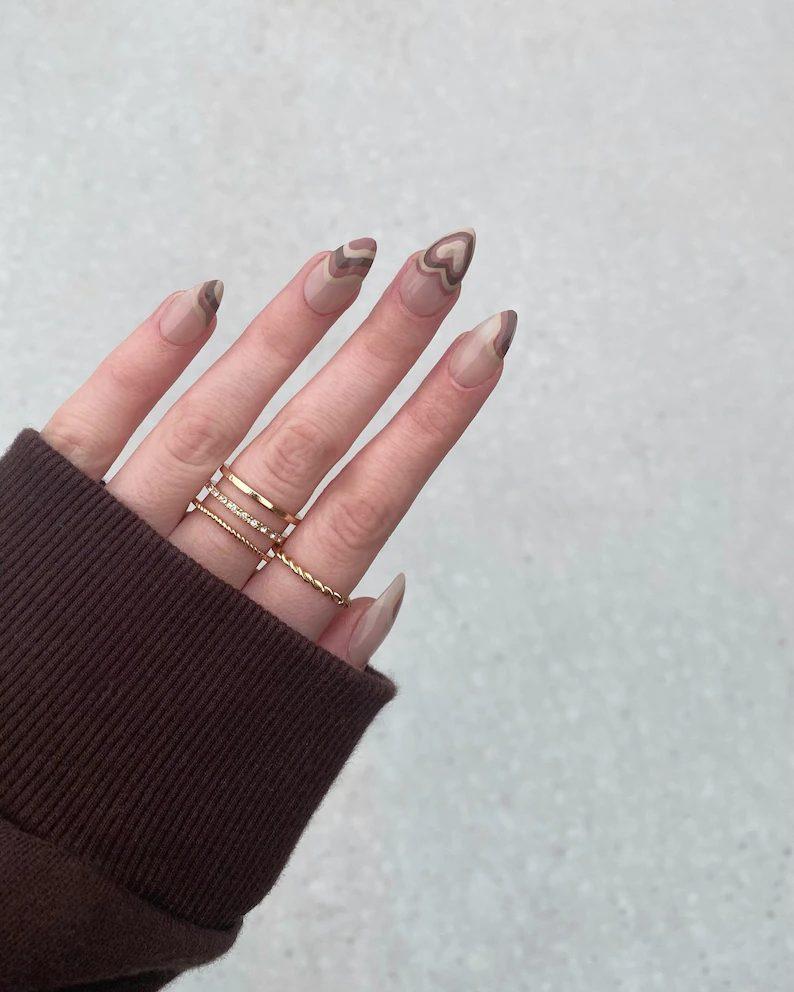 Cute brown abstract nails with hearts nail art