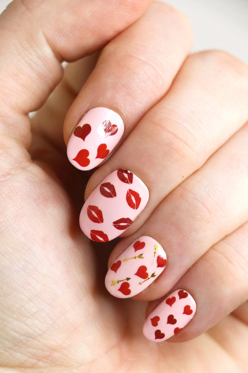 Cute short light pink nails with red lips and hearts