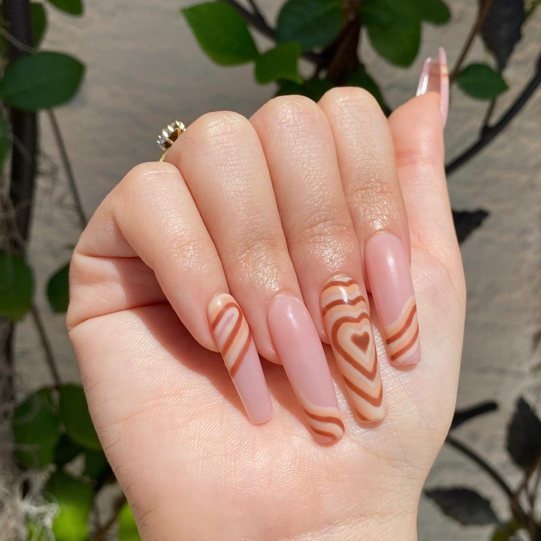 Long brown abstract heart nails
