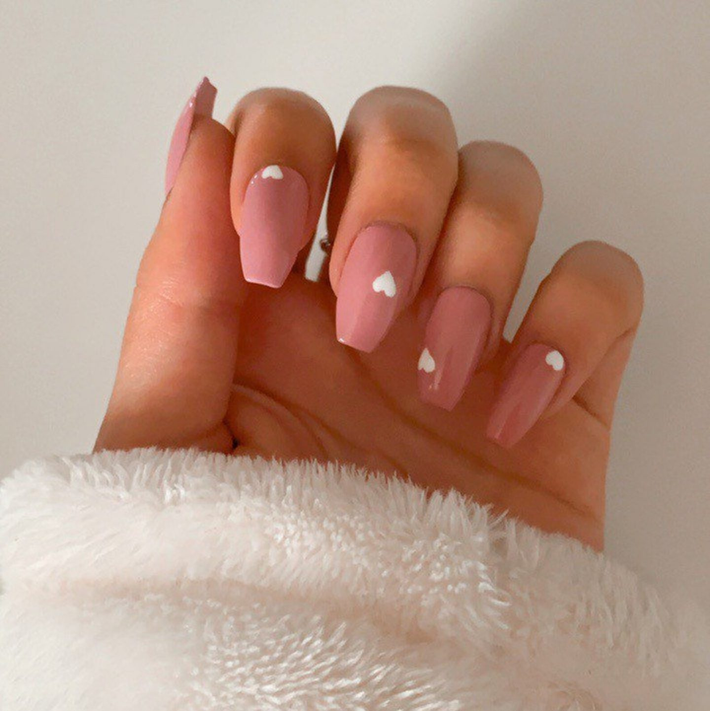Short pink coffin nails with small white hearts